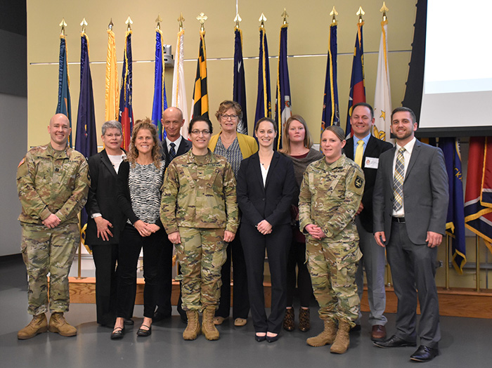 Army Capt. Scott Wynocker, Marie Cochran, Sage Norton, Stephen Matthews, Army Col. Gina E. Adam, USAMMDA commander, Rene Smith, Lindsay Longobardi, Michelle Ehlert, Army Maj. Janessa Moyer, Timothy Hales, and Juston Donadieu
